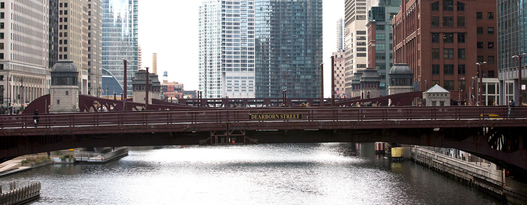 Dearborn Street bridge over the river with skyscrapers in the background